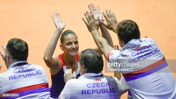 Czech's Karolina Pliskova celebrates with team members after defeating Germany's Angelique Kerber in their match of the tennis Fed Cup semifinal...