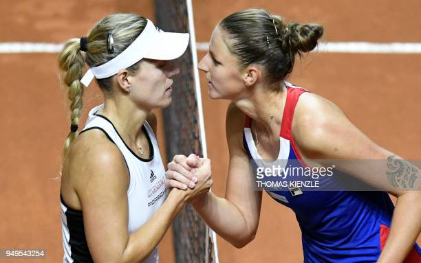 Czech's Karolina Pliskova is congratulated by Germany's Angelique Kerber after their match of the tennis Fed Cup semifinal between Germany and Czech...