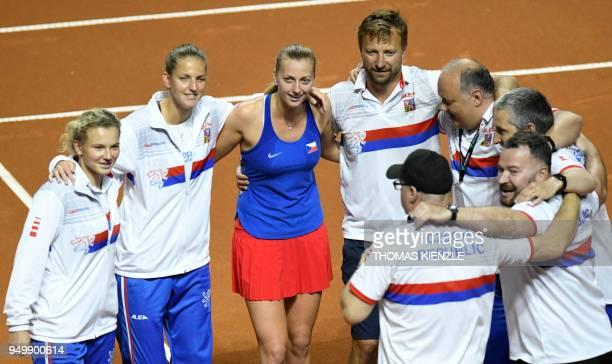 Czech's Katerina Siniakova Karolina Pliskova and Petra Kvitova celebrate after Kvitova's victory against Germany in the tennis FedCup World Group...