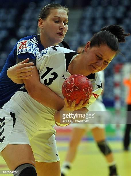 Czech's Klara Cerna vies with Ukraine's Olha Vashchuk during the Women's Euro 2012 handball championship match Ukraine vs Czech Republic on December...