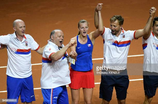 Czech's Petra Kvitova and teammates celebrate after her victory against Germany's Angelique Kerber during the tennis FedCup World Group semifinal...