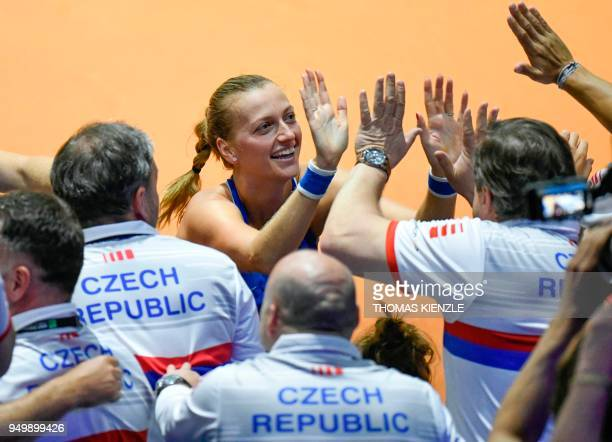 Czech's Petra Kvitova celebrates with teammates after her victory against Germany's Angelique Kerber during the tennis FedCup World Group semifinal...