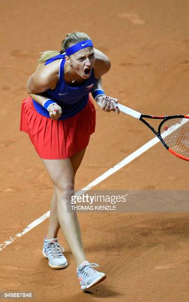 Czech's Petra Kvitova reacts in her match against Germany's Angelique Kerber during the tennis FedCup World Group semifinal between Germany and Czech...