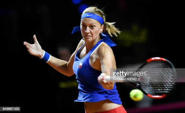 Czech's Petra Kvitova returns the ball to Germany's Angelique Kerber during their match of the tennis FedCup World Group semifinal between Germany...
