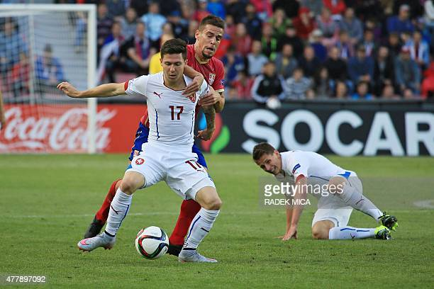 Czech's Tomas Prikryl vies for the ball with Serbia's Aleksandar Kovacevic during the UEFA Under21 European Championship 2015 football match between...