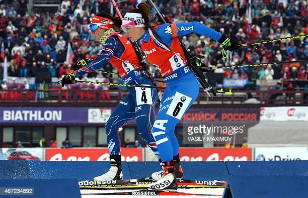 Czech's Veronika Vitkova and Italy's Dorothea Wierer compete during the women's 125 km mass start event of the Biathlon Word Cup in the Siberian city...