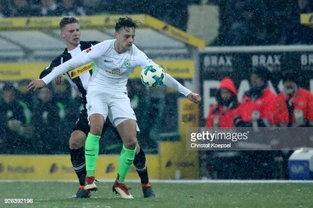 d Nico Elvedi of Moenchengladbach challenges Robert Bauer of Bremen uring the Bundesliga match between Borussia Moenchengladbach and SV Werder Bremen...