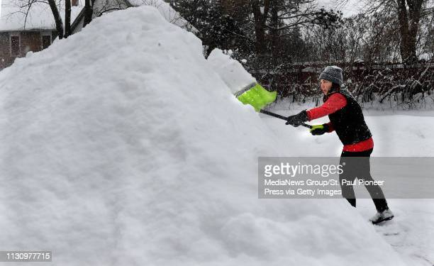"""D prefer this to being stuck on the 405 ,"""" said Heather McLean, formerly from Los Angeles and now living in Stillwater as she shovels snow Wednesday,..."""