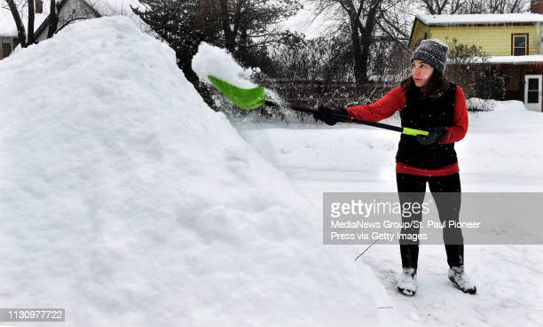 """D prefer this to being stuck on the 405 ,"""" said Heather McLean, formerly from Los Angeles and now living in Stillwater, as she shovels snow..."""