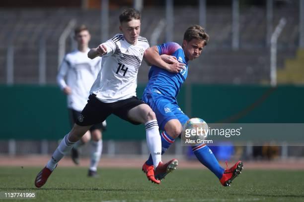 d14 of Germany U17 is challenged by Orri Hrafn Kjartansson of Iceland U17 during the UEFA Elite Round match between Germany U17 and Iceland U17 at...