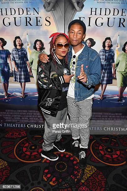 Da Brat and Pharrell Williams attends Hidden Figures advanced screening hosted by Janelle Monae Pharrell Williams at Regal Cinemas Atlantic Station...
