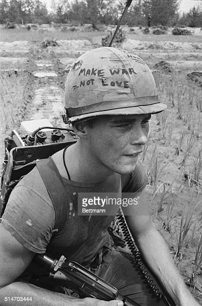 Da Nang South Vietnam Marine Cpl Michael Wynn of Columbus Ohio seems to be trying to get a message across with a takeoff of the hippie slogan make...