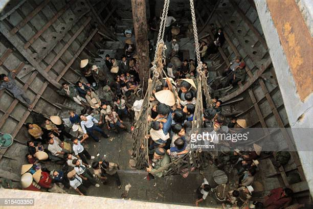 Da Nang, South Vietnam- ORIGINAL CAPTION READS: Refugees who fled from northernmost South Vietnam are unloaded by crane and cargo net from a...