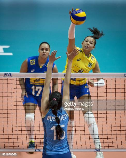 Da Silva Ana Carolina of Brazil in action against Busquets Reyes of Argentina during the FIVB Volleyball Nations League match between Brazil and...