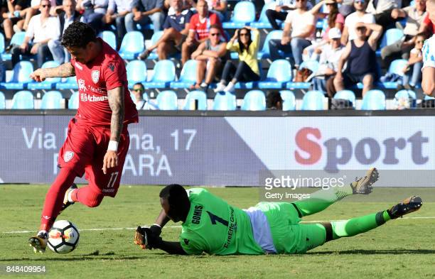 Da Silva Diego Farias of Cagliari Calcio competes for the ball with Alfred Gomis of Spal during the Serie A match between Spal and Cagliari Calcio at...