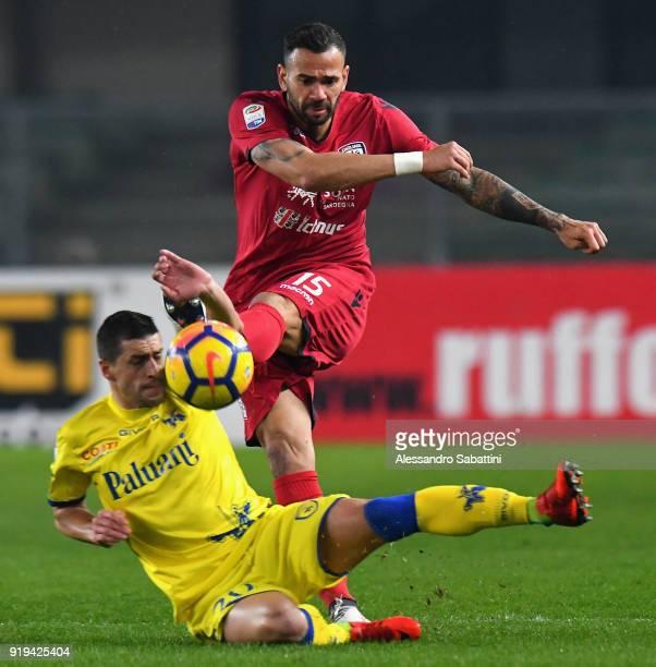 Da Silva Leandro Castan of Cagliari Calcio competes for the ball whit Manuel Pucciarelli AC Chievo Verona during the serie A match between AC Chievo...