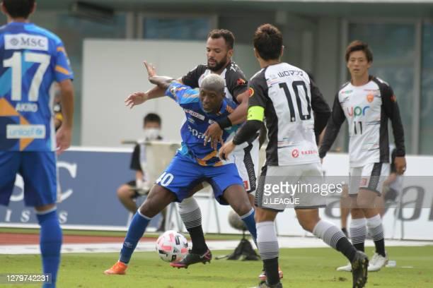 Da Silva Silveira of V-Varen Nagasaki and RENAN Dos Santos Paixao of Renofa Yamaguchi battle for the ballduring the J.League Meiji Yasuda J2 match...