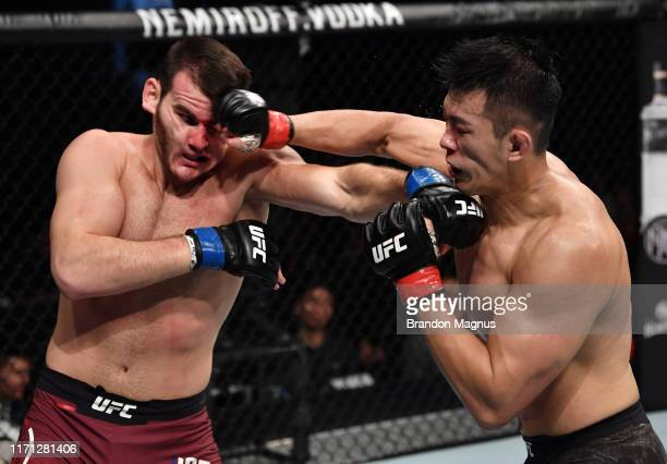Da Un Jung of South Korea punches Khadis Ibragimov of Russia in their light heavyweight bout during the UFC Fight Night event at Shenzhen Universiade...