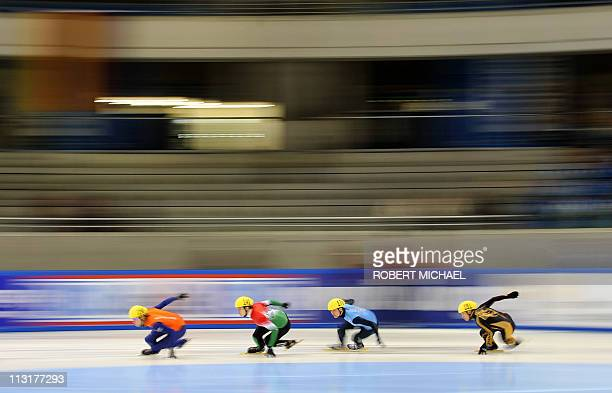 Daa Breeuwsama from Netherland Vikor Knich of Hungary Simon Cho of USA and Yuma Sakurai of Japan compete in the men's 500m preliminaries in the men's...