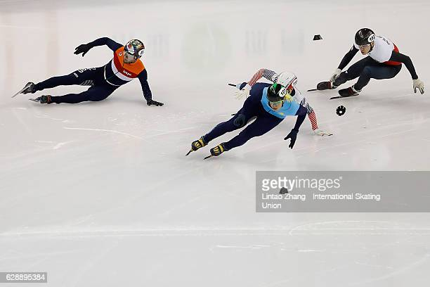 Daan Breeuwsma of the Netherlands fall after crash with Aidar Bekzhanov of Kazakhstan Han SeungSoo of South Korea and Bartosz Konopko of Poland...