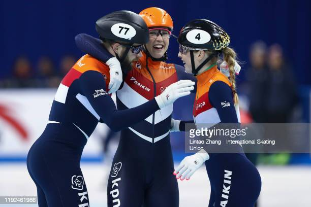 Daan Breeuwsma Suzanne Schulting and Lara van Ruijven of Netherlands celebrate after winning gold in the 2000m Mixed Relay of the ISU World Cup Short...