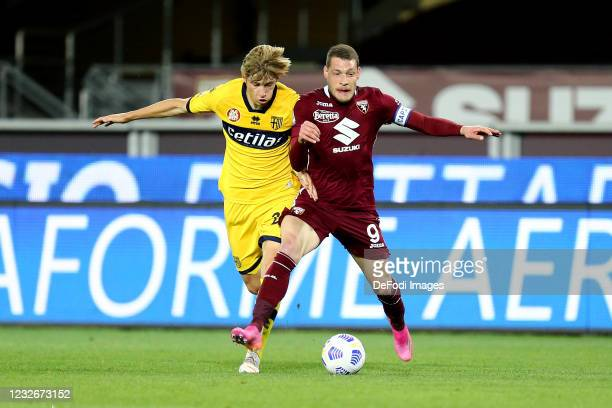 Daan Dierckx of Parma Calcio and Andrea Belotti of Torino FC battle for the ball during the Serie A match between Torino FC and Parma Calcio at...