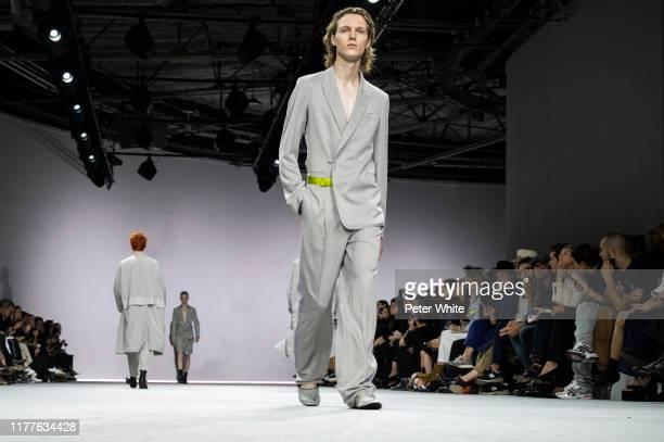 Daan Duez walks the runway during the Haider Ackermann Womenswear Spring/Summer 2020 show as part of Paris Fashion Week on September 28, 2019 in...