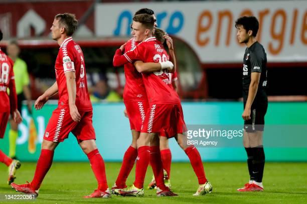 Daan Rots of FC Twente celebrates with Ramiz Zerrouki of FC Twente after scoring his sides second goal during the Dutch Eredivisie match between FC...
