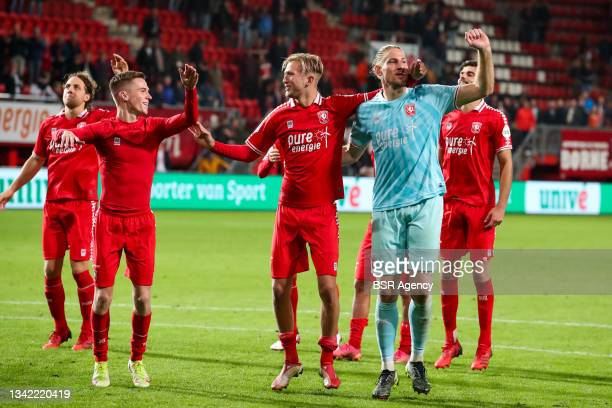 Daan Rots of FC Twente, Michel Vlap of FC Twente and Lars Unnerstall of FC Twente their sides win during the Dutch Eredivisie match between FC Twente...