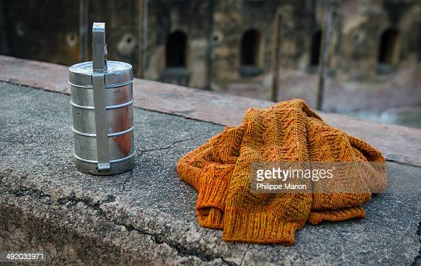 a dabba, or indian-style tiffin box and a pullover - tiffin box photos et images de collection