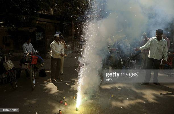 Dabbawallas or lunchbox deliverers burn fire crackers to celebrate the execution of Pakistanborn Mohammed Kasab the sole surviving gunman of the 2008...