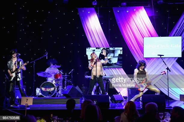 Dabney Tellum Hugh Jass and Moe Lato of The Wayward Sons perform on stage during the Venice Family Clinic Silver Circle Gala at The Beverly Hilton...