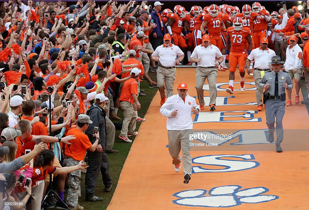 Dabo Swinney of the Clemson Tigers runs to the field during their game at Memorial Stadium on November 7, 2015 in Clemson, South Carolina.
