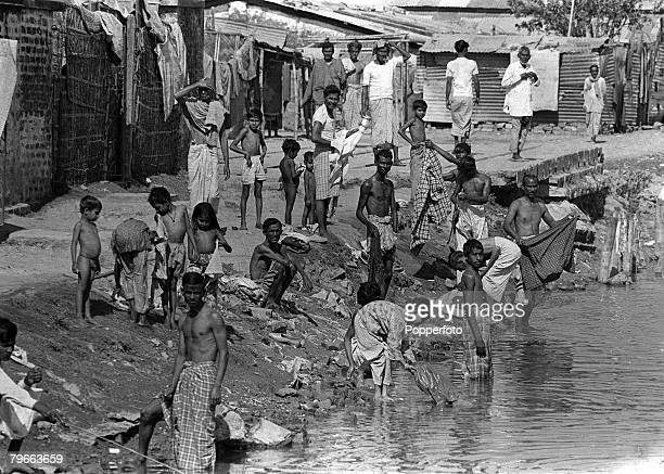 Dacca East Pakistan 30th December 1971 Refugees from the IndiaPakistan conflict pictured washing their clothes in the river at Dacca