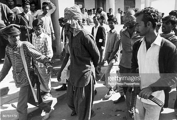 Social History People Asia Dacca East Pakistan pic circa 1971 Blindfolded and with hands tied two prisoners are led through Dacca and to jail by a...