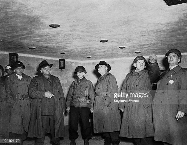 Dachau concentration camp in Germany A group of American officers and two civilians from the party of the research on Nazi camps congress inspecting...