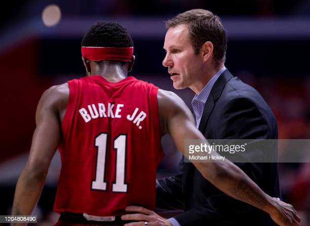 Dachon Burke Jr. #11 talks with Head coach Fred Hoiberg of the Nebraska Cornhuskers during the game against the Illinois Fighting Illini at State...