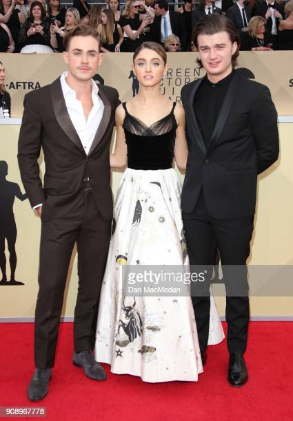 Dacre Montgomery Natalia Dyer and Joe Keery arrive at the 24th Annual Screen Actors Guild Awards at The Shrine Auditorium on January 21 2018 in Los...