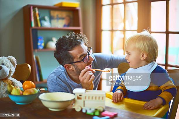 dad always makes food time fun - feeding stock pictures, royalty-free photos & images
