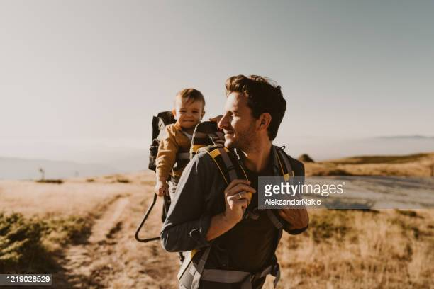 dad and baby boy during the hike adventure - active lifestyle stock pictures, royalty-free photos & images