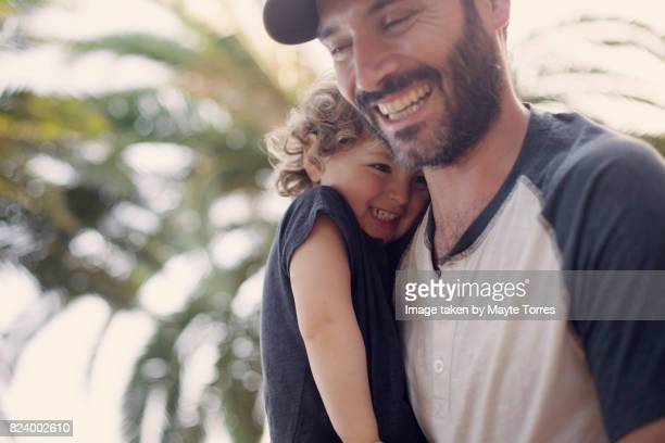 dad and boy laughing together