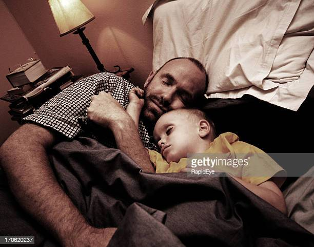 Dad and child fast asleep