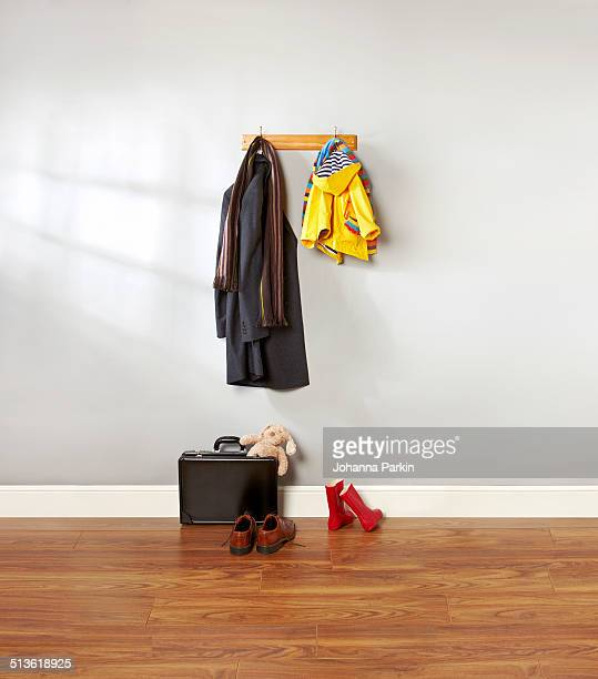 dad and child's coat hanging up in hallway - coat stock pictures, royalty-free photos & images