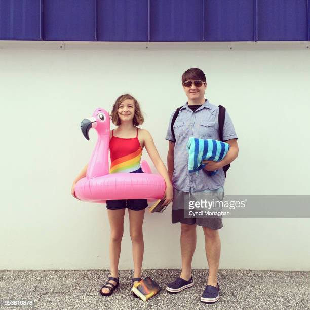 Dad and Daughter and Inflatable Flamingo