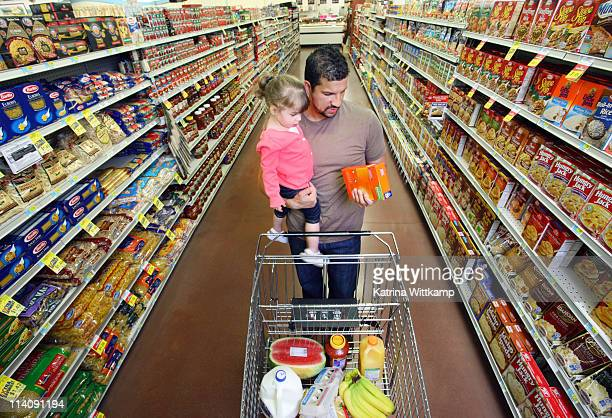 Dad and daughter at grocery store