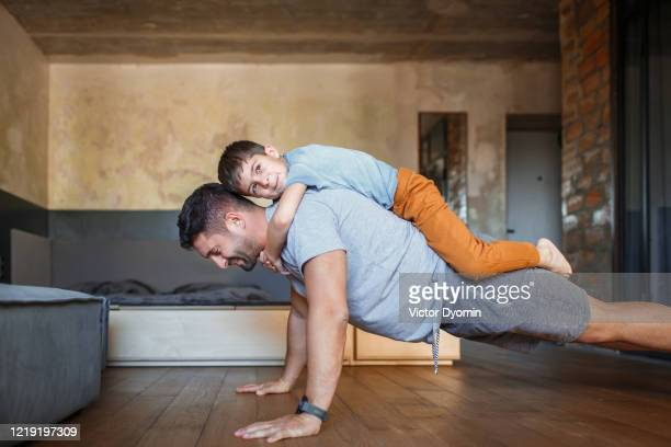 dad and his little son play sports together - スポーツ  ストックフォトと画像