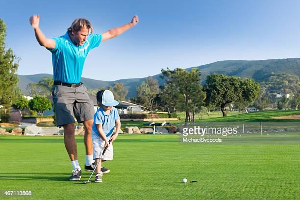 Dad and Little Boy Golfing Celebration