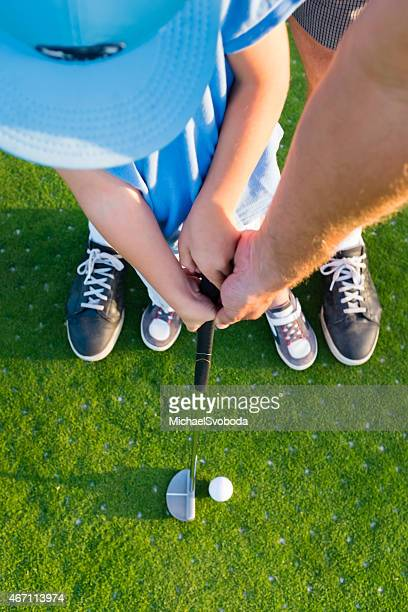 dad and little boy golfing pov - putting stock pictures, royalty-free photos & images