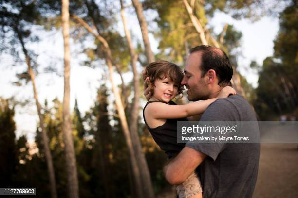 dad and son bonding in the countryside - autism awareness stock pictures, royalty-free photos & images