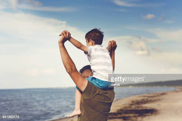Dad and son enjoying the sea views